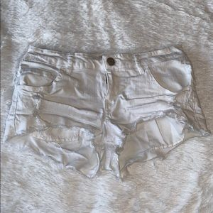 Distressed white shorts